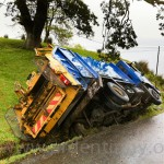 Council refuse truck topples into ditch