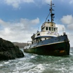 Historic tug comes to rest in rocky inlet