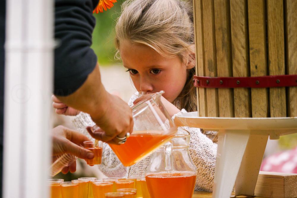 Sampling the delights of freshly pressed apple juice