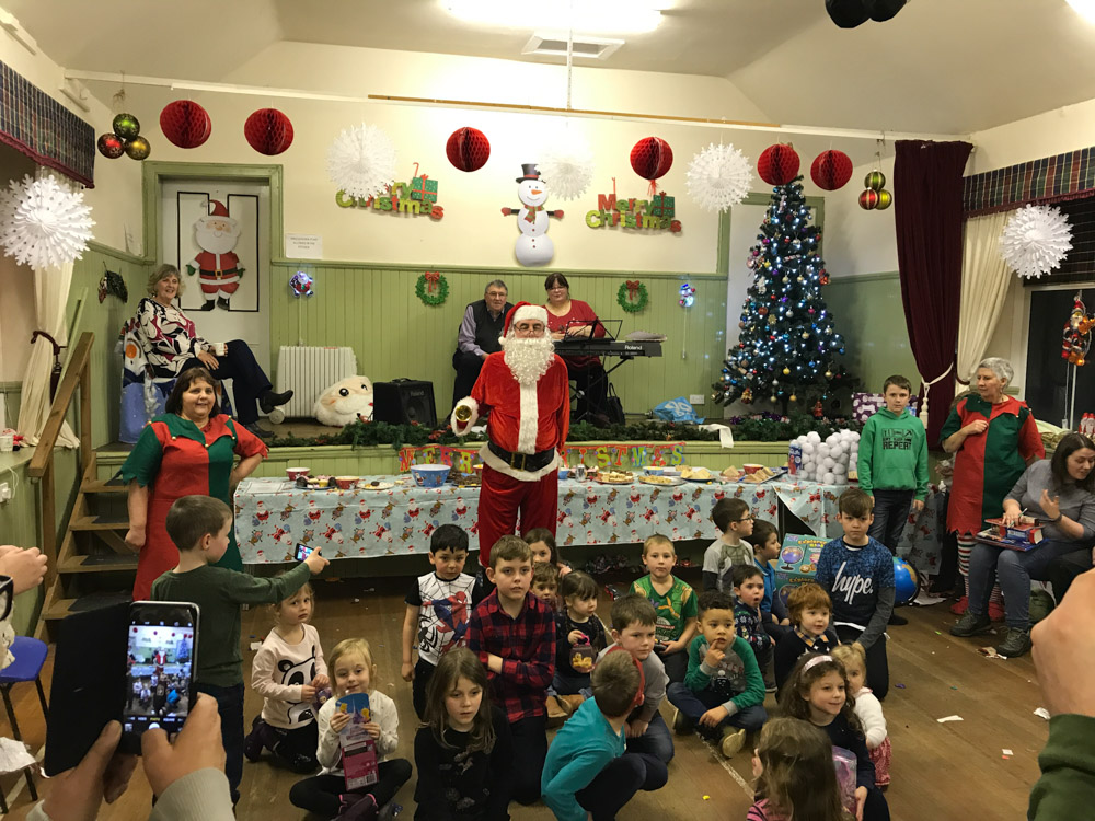 Santa entertains at Village Hall party